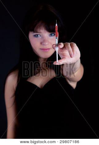 Drug addiction. Focus is on the syringe