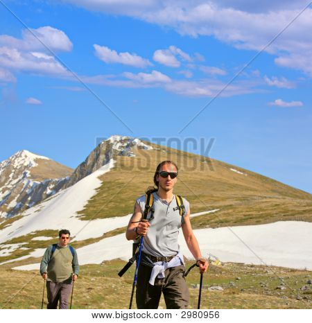 Backpackers On A Mountain