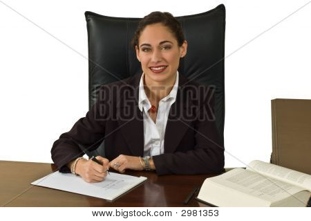 Pretty Business Woman At Her Desk