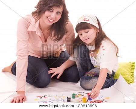 Happy family, young beautiful mother and her little daughter with color paint