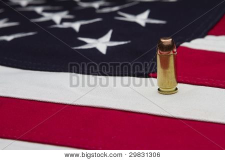 US Flag and a single bullet