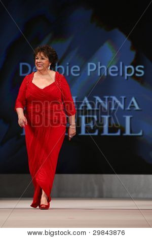 NEW YORK - FEBRUARY 8: Debbie Phelps wears Adrianna Papell at The Heart Truth's Red Dress Collection 2012 Fashion Show at the Hammerstein Ballroom on February 8, 2012 in New York City.