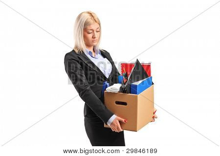 A fired businesswoman in a suit carrying a box of personal items isolated on white background