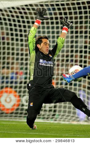 BARCELONA - FEB, 4: Claudio Bravo of Real Sociedad in action during the Spanish league match against FC Barcelona at the Camp Nou stadium on February 4, 2012 in Barcelona, Spain