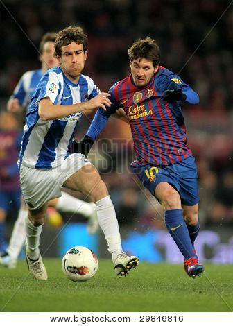 BARCELONA - FEB, 4: Mikel Gonzalez(L) of Real Sociedad vies with Leo Messi(R) of FC Barcelona during the Spanish league match at the Camp Nou stadium on February 4, 2012 in Barcelona, Spain