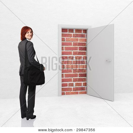standing woman and closed door