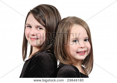 Adorable little sisters isolated on white background
