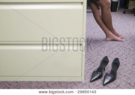 Feet and shoes of businesswoman in office
