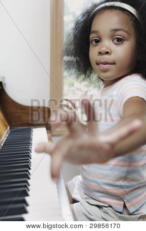 Portrait of girl playing piano