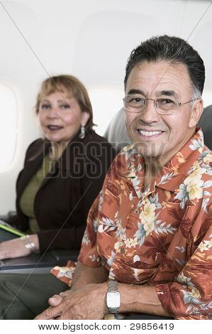 Portrait of couple on airplane