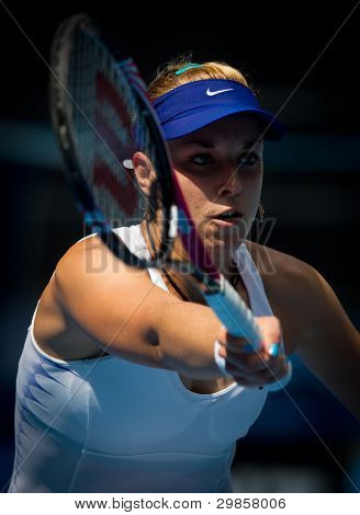 MELBOURNE - JANUARY 21: Sabine Lisicki of Germany in her third round win over Svetlana Kuznetsova of Russia  at the 2012 Australian Open on January 21, 2012 in Melbourne, Australia.