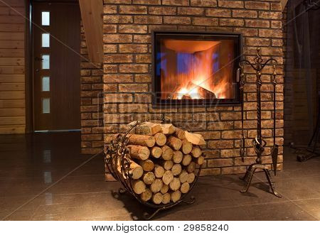 Fire wood against a fireplace