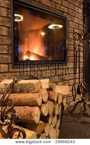 Interior with a fireplace and fire wood