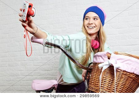 Young woman photographing a bicycle before shopping