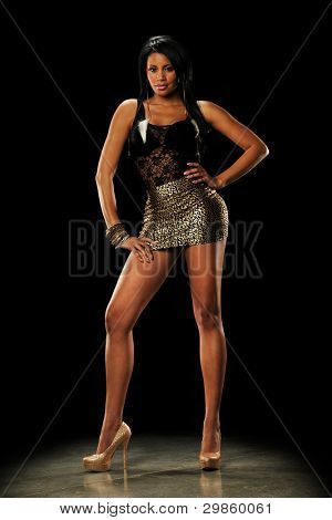 Picture or Photo of Young Black Woman wearing a mini skirt n a dark background