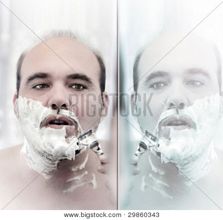 Portrait of a balding man shaving with mirror reflection