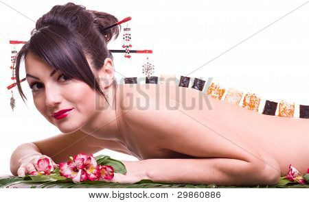 Young beautiful woman with Japanese sushi rolls