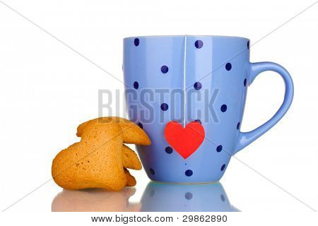 Blue cup with tea bag and heart-shaped cookies isolated on white
