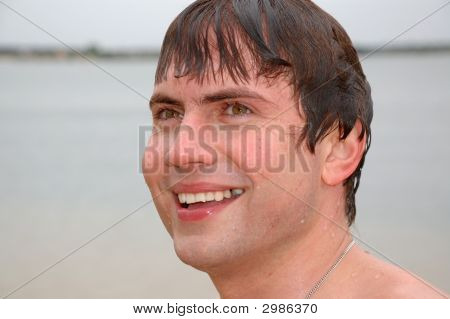 Young Pretty Smiling Swimmer
