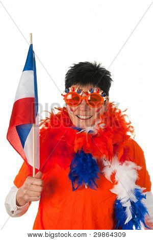 Dutch woman dressed in orange with Holland flag as a soccer fan