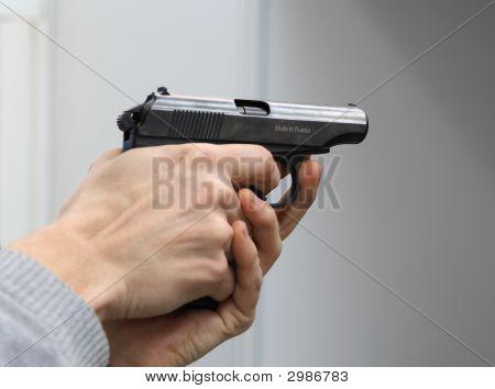 Gun In A Man'S Hands