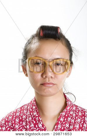 Young Girl In Curlers And Large Glasses