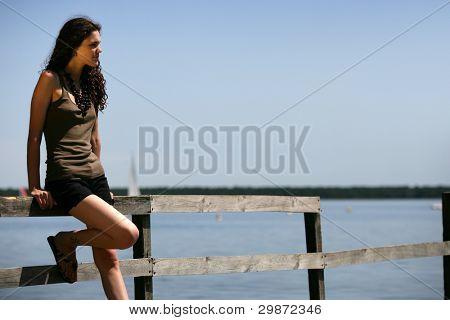 Woman stood alone on jetty