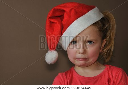 Sad girl in santa cap