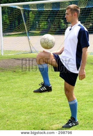 Soccer Player On The Field