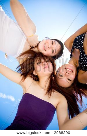 Young Girls Gather Around Under The Bright Sunny Sky