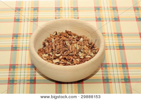 Walnuts In A Wooden Bowl On A Table