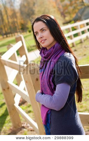 Portrait of young woman in country field