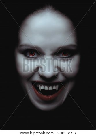 Woman Vampire With Fangs On A Black Background