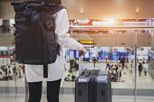 Young Woman Wearing Casual Clothes Is Posing At Airport, Traveler Woman Plan And Backpack See The Ai poster