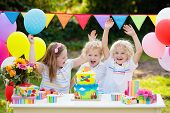 Children Blow Candles On Birthday Cake. Kids Party poster
