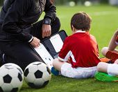 Coach Coaching Preschool Soccer Boy. Youth Coach Explaining Tactics Basics Of Soccer On Tactic Board poster