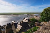 Battle Between Water And Land. High Tide Water Is Going To The Bridge Between Mont Saint-michel Abbe poster