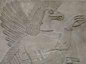 stock photo of babylonia  - Ancient Assyrian wall carvings of an eagle - JPG
