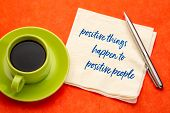 positive things happen to positive people - handwriting on a napkin with a cup of coffee, law of att poster