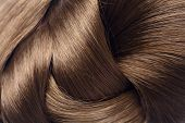stock photo of hair streaks  - long brown hair as background - JPG