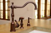 stock photo of spigot  - Faucet in a kitchen sink - JPG