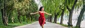 Happy woman running carefree and in freedom enjoying breathing healthy in beautiful summer park bann poster
