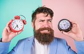 Does Changing Clock Mess With Your Health. Man Bearded Hipster Hold Two Different Clocks. Guy Unshav poster