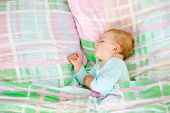 Adorable Little Baby Girl Sleeping In Bed. Calm Peaceful Child Dreaming During Day Sleep. Beautiful  poster