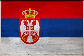 Close-up Of Old Metal Wall With National Flag Of Serbia. Concept Of Serbia Export-import, Storage Of poster