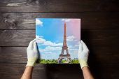 Photography Printed On Canvas With Gallery Wrap Method Of Canvas Stretching In Male Hands. Image Of  poster