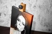 Photography Printed On Canvas With Gallery Wrap. Portrait Of A Beautiful Young Woman. Wooden Easel A poster