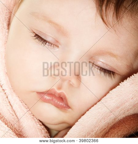 cute infant baby sleeping, beautiful kid's face closeup, studio shot