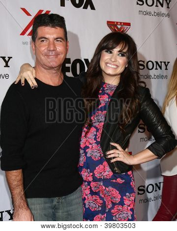 LOS ANGELES - DEC 6:  Simon Cowell, Demi Lovato arrives to the X Factor 2012 Final Four Party at Rodeo Drive on December 6, 2012 in Beverly Hills, CA