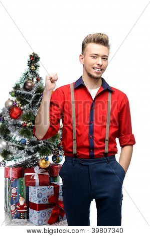 young vintage man standing near christmas tree